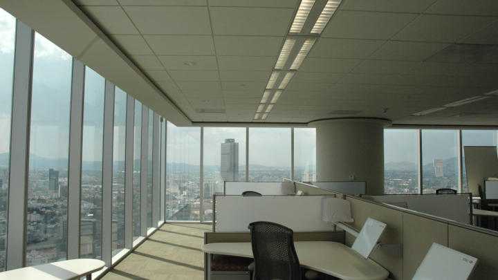 Work area of the HSBC tower with the outside view lit by Philips lighting