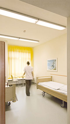 Patient room at the psychiatric clinic lit by Philips