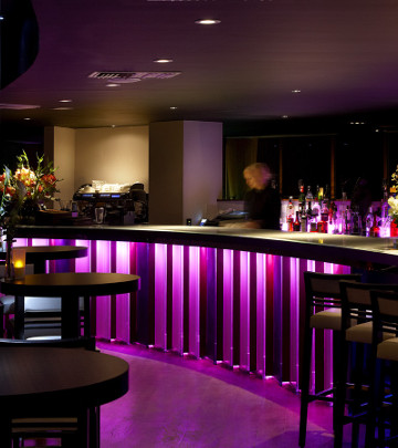 The bar at Rafayel Hotel utilizes energy-efficient hotel lighting from Philips