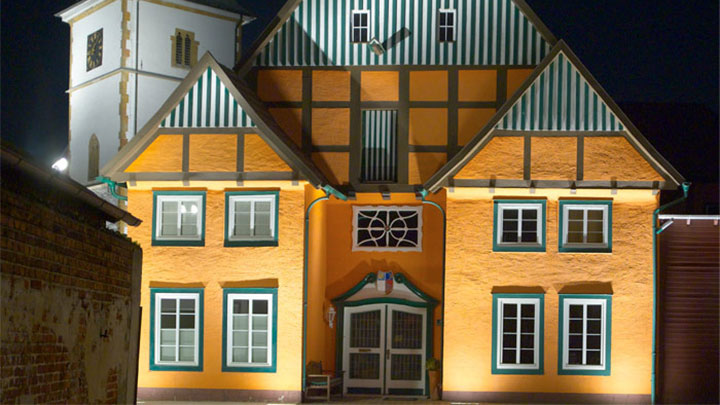 Facade of a building at the historic Ritberg illuminated by Philips