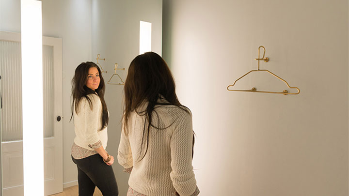 "A SuperTrash customer checks her reflection in Philips' AmbiScene Mirror, on the ""Day"" light setting"