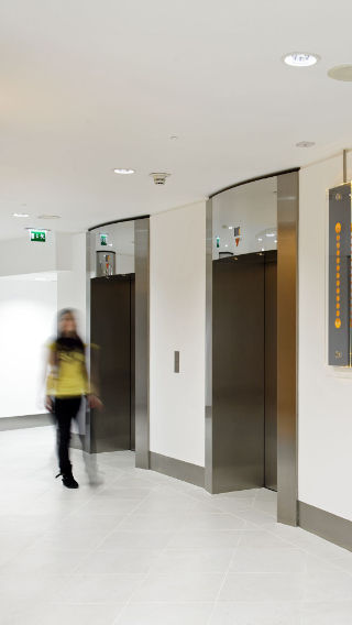 Corridor and elevators in the Tower 42 building, lit using Philips office lighting