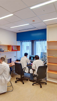 People work by the light of Philips' hospital energy saving lighting in this UMCG office