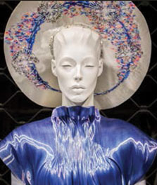 A mannequin wears a blue dress, which is color-enhanced by Philips LED flavors | Shop window display lights